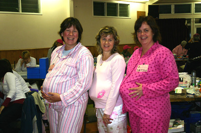 Three_pregnant_ladies_dressed_in_pink_pj