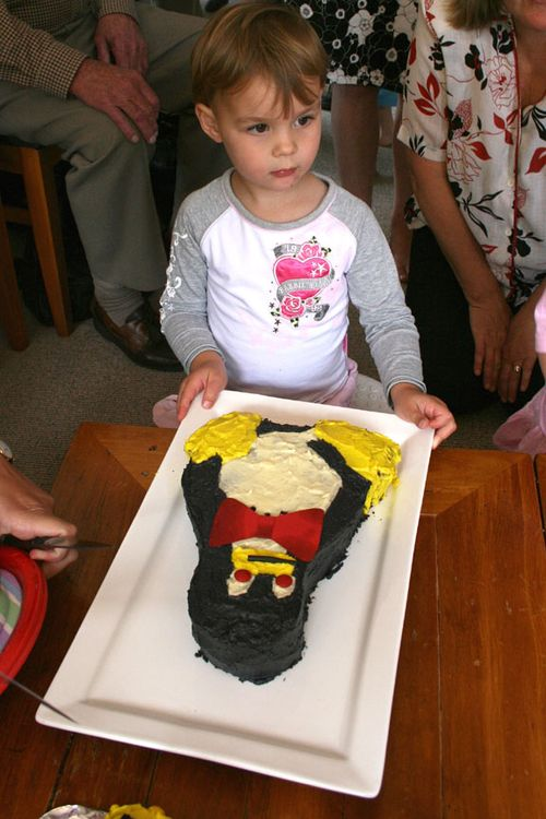 Sarah with her penguin cake smaller
